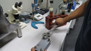 Mission Rubber Compression Set Test: measuring the ability of rubber/elastomers to sustain elastic properties after extended compressive stress.
