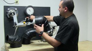 Mission Rubber Vacuum Resistance Testing: measuring the resistance to collapse of truck intake hoses.